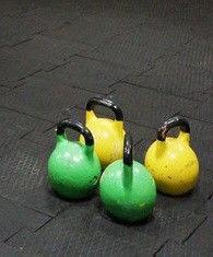 Резиновая плитка для занятий тяжелыми видами спорта