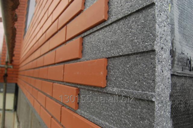 Heat-insulating panels for a facade under a brick tile
