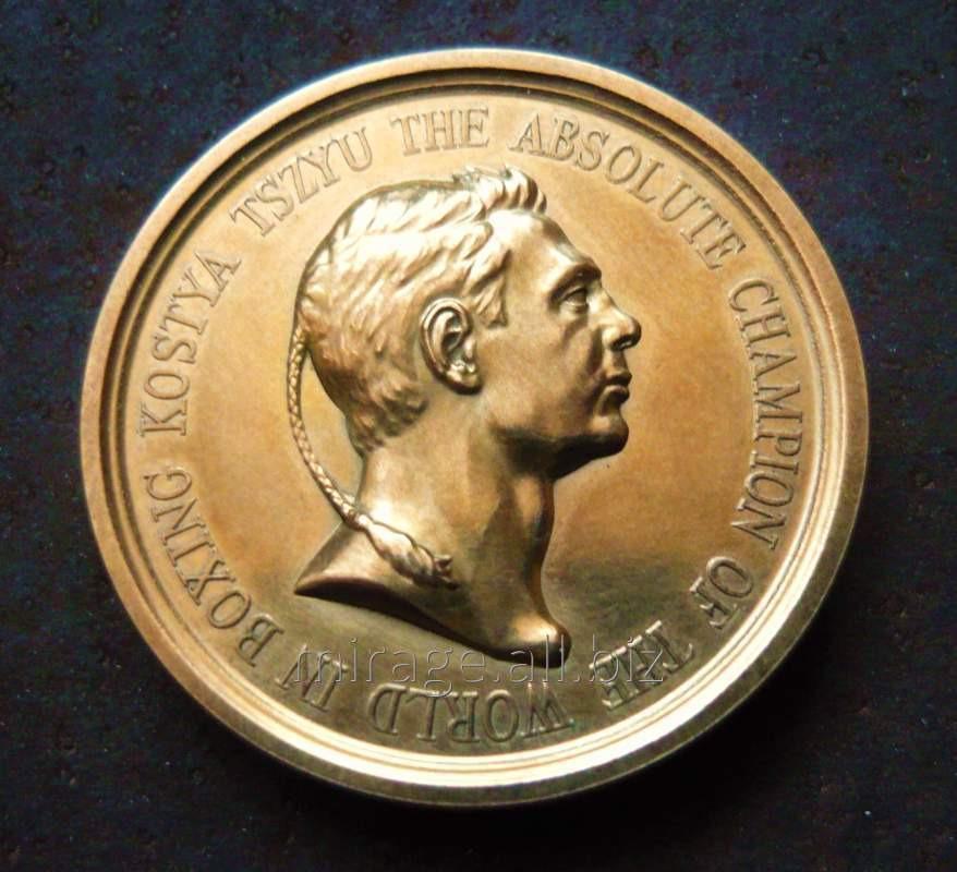 Сувенирная медаль чемпиону мира по боксу К.Дзю