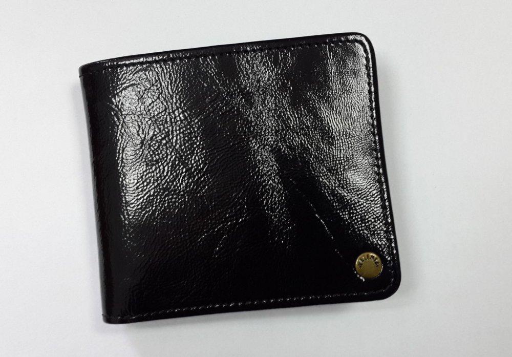 Женское кожаное портмоне Valenta черный лак