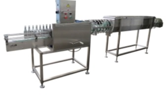 Machine for rinsing and steaming containers of H1-BER