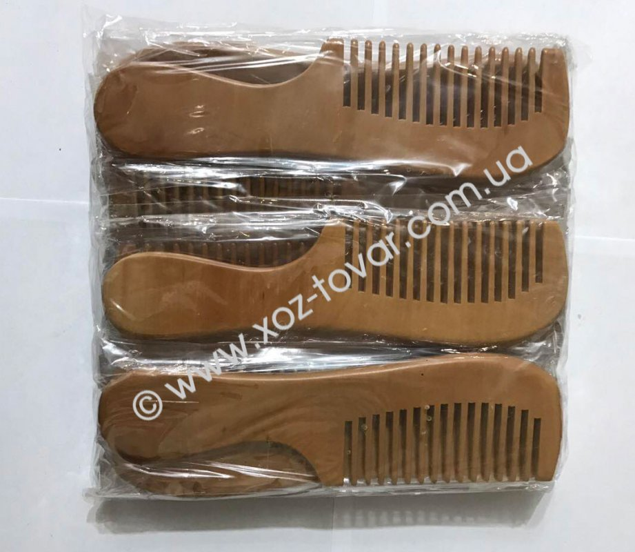 The hairbrush is wooden wide, piece.