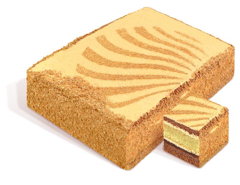 Торт «Золотой Ключик» бисквитный, каждый слой покрыт сливочным кремом с вареным сгущенным молоком, украшен узорами из бисквитной крошки. Вес: 2 кг. ГОСТ.