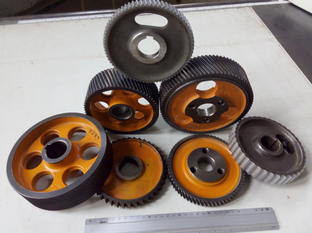 Колеса металеві механізму подачі чотирьохбічного верстата