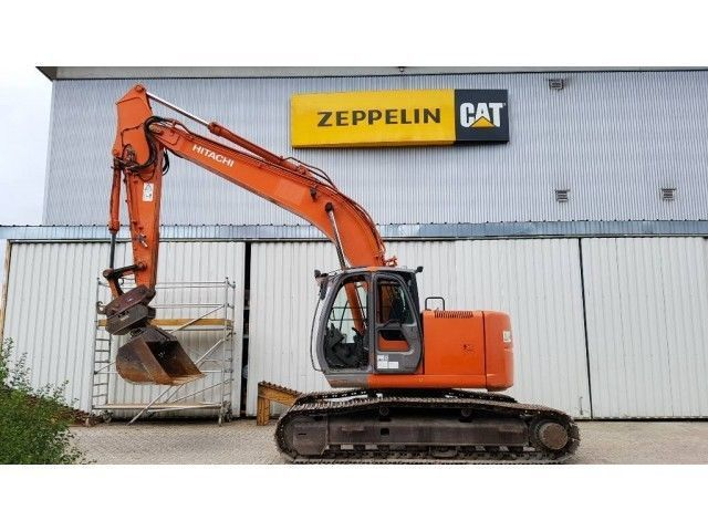 Buy Caterpillar Hitachi CX225US excavator.