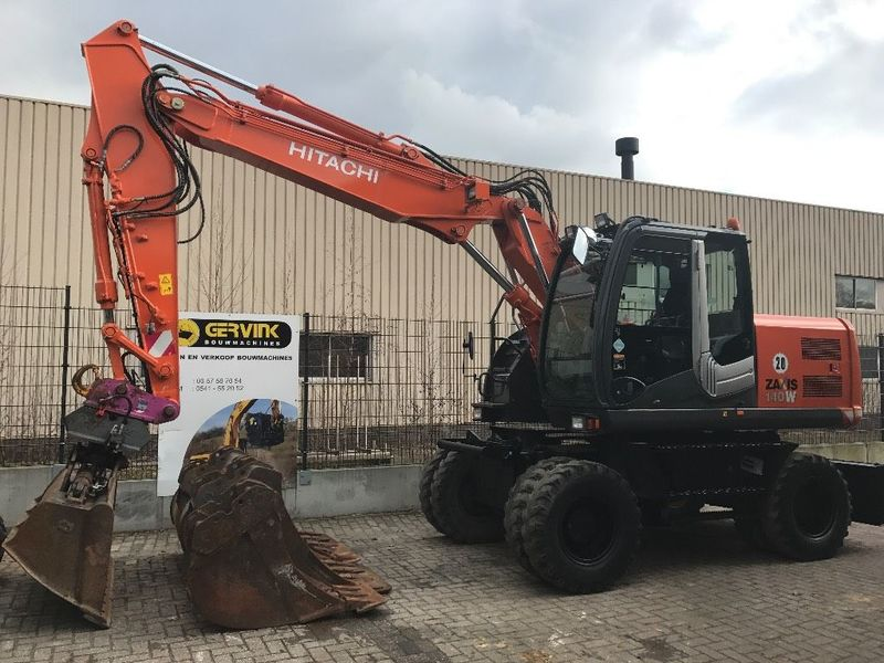 Wheel Hitachi ZX 140 W-3, 2009 excavator.