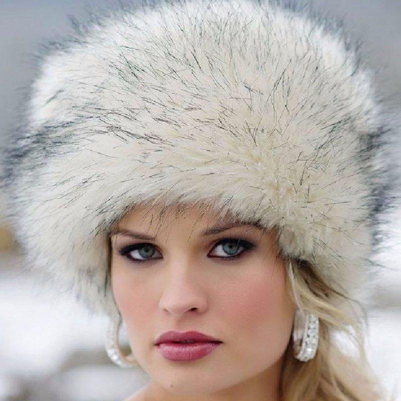 Женские теплые шапки с искусственного меха лисы.