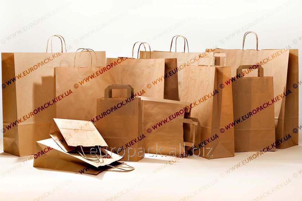 """Бумажные пакеты с крученными и плоскими ручками из крафт бумаги """"на вынос"""". Выдерживают вес до 15 кг."""