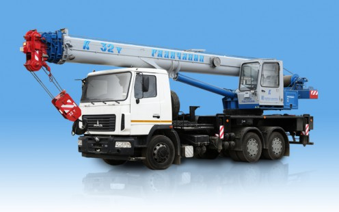 The KS-55729 truck crane, loading capacity is 32 tons, length of an arrow is 30,2 meters