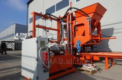 Vibropress for manufacture of paving slabs and