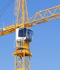 Load-lifting tower cranes.