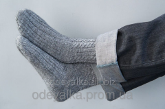 Knitted socks from sheep wool of handwork