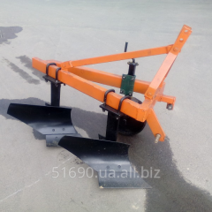 The hinged equipment to the motor-block, plows to