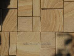 Tile sawn of a stone of sandstone natural.