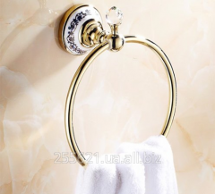 The holder for towels gold