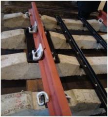 Compensators temperature for a rail, for