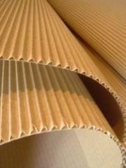 Glue for a corrugated cardboard, production of