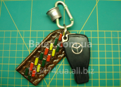 Spectacle-cases, playing cards, lighters, cigarettes, flasks and gift bottles