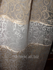 Curtain to a window sill 36_1 and 36_2 curls a