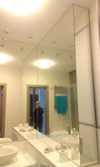Big mirrors in a small bathroom with installation.