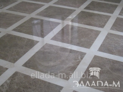 Floor from a natural stone of gray color