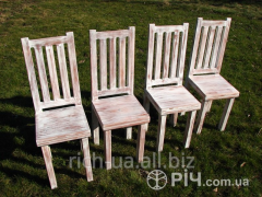 Shebb chic. Chairs, stools, benches and a table in