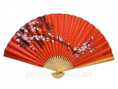 Fan wall the Oriental cherry on a red background