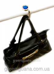 Hanger for a female handbag with pastes the