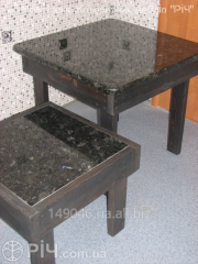 Dining table from a tree with a granite table-top