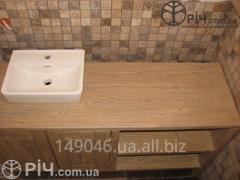 Curbstone under a wash basin for a bathroom