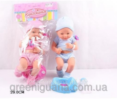 Baby doll with accessories, a pot, in a package of