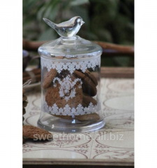Glass jar with a pattern decorated by a bird