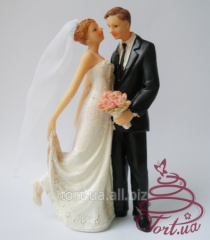 Elegant figurine on top of Fine Moment wedding