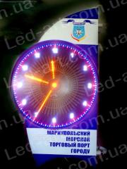 The LED electronic street clock imitating an arrow