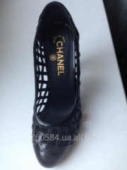 Chanel shoes are black, the size 37