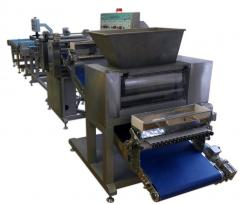 Equipment for production of cakes for cakes...