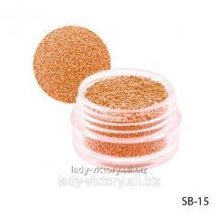 Orange paillettes in a round container. SB-15