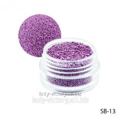 Light-violet paillettes in a round container.