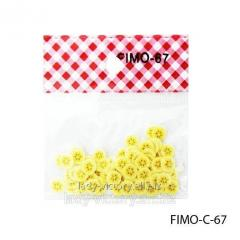 FIMO figures in the form of light yellow fruit.