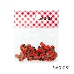 FIMO figures in the form of ladybugs of red color.