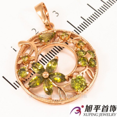All gold plated pendant with green stones 524,106