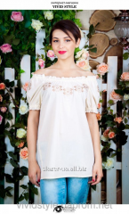 The white blouse embroidered in the flowers