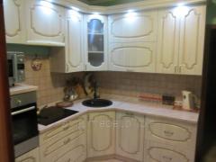 The kitchen is angular cream