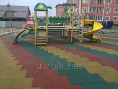 Rubber paving slabs for a floor of playgrounds