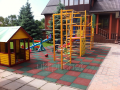 Rubber tile for private playgrounds
