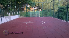 Rubber covering for sports grounds