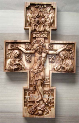 The cross with a crucifix, carved from natural
