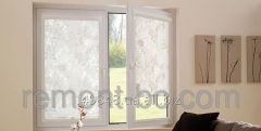 Fabric roleta on a kitchen window