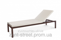 Chaise lounges from an artificial rattan of