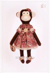 Monkey Lucie. Textile toy Tilde. Handwork